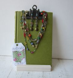 Here is a necklace / earring jewelry display that I came up with using recycled book covers. There are so many options with this display;