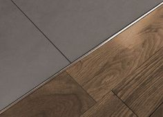Tile to wood transition strip