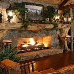 99 Inspiring Rustic Christmas Fireplace Ideas to Makes Your Home Warmer. Is this a gas fireplace. Country Fireplace, Cabin Fireplace, Rustic Fireplaces, Christmas Fireplace, Fireplace Design, Rustic Christmas, Fireplace Ideas, Stone Fireplaces, Log Cabin Christmas