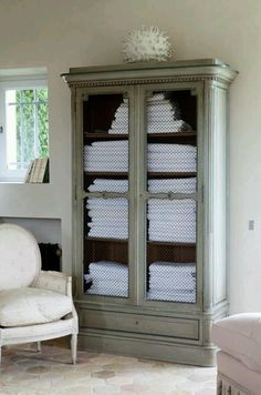 All white towels stacked neatly in a beautiful armoire, is always appealing to my eyes.