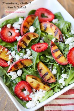 A light and refreshing summer grilled peach spinach salad with sliced strawberries and homemade salad dressing.