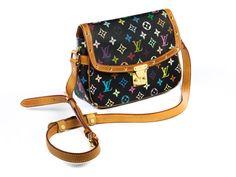 """Ca. 21 x 25 x 7 cm. Schwarze Cross-body-Bag mit """"Louis Vuitton Multicolour""""-Monogramm, Lederbesätzen, goldfarbenen Beschlägen und Nieten. Innenraum mit..."""