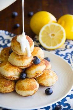 Lemon – Blueberry Pancake Bites – Portable lemon blueberry pancake poppers drenched in a cream cheese icing makes for a yummy weekend breakfast treat!   Today I'd like to welcome Felesha from the Say Grace blog for sharing with us. She has a special breakfast treat to share. And I'm so excited. Let's get …