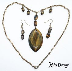 Blue tiger eye gemstone pendant necklace earrings set The main color is bronze and brown, with the bluish-grey colors of the gemstone Full length of the necklace is inch) The pendant is 50 x 32 mm x inch) The earrings are 26 x x (without the hook), full Blue Tigers Eye, Tigers Eye Gemstone, Bluish Gray, Earring Set, Gemstone Jewelry, Bronze, Pendants, Pendant Necklace, Gemstones