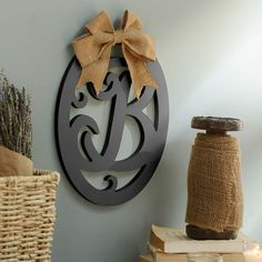 Leave your mark in rustic style with this Wooden Monogram Wall Plaque! The deep black color and burlap bow make this letter look country chic.