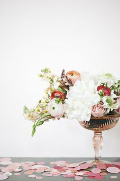 Like the shape of this arrangement - how it spills over, the bowl vase is pretty too