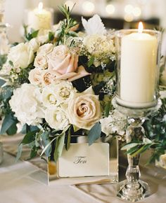 This Blush and Ivory Rose and Hydrandea Low Centerpiece, guestbook table