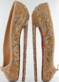 """Louboutin 8 inch ballet-inspired spike shoes.  Golden silk and Swarovski crystals with red sole. Created to be auctioned to raise funds for the English National Ballet. Louboutin: """"The heel which makes dancers closer than any other women to the sky, closer to heaven."""""""