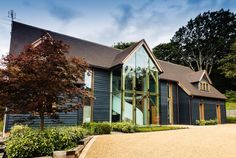 Award winning hand-crafted oak framed buildings, bespoke oak frame houses, and timber frame extensions as featured on Grand Designs. Porch Extension, Tree House Interior, Glass House Design, Oak Framed Buildings, Oak Frame House, Bungalow Renovation, Glass Facades, Timber Frame Homes, Big Windows