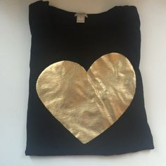 J. Crew gold metallic heart tee J. Crew black tee with gold metallic heart. Size large. 100% cotton. Worn a couple times. In GREAT condition! Short sleeve. Crew neck. J. Crew Tops Tees - Short Sleeve
