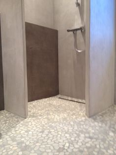 grey pebble floor with beton cire walls