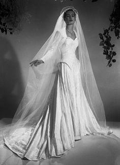 August 1951;a wedding dress by Mercia, the long veil in held in place by a tiara