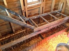Old ladders serve as a roost for the chicken coop. Manure box underneath.
