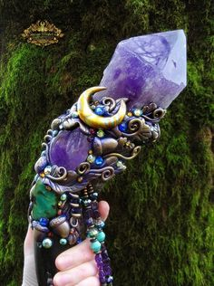 "The main power crystal of FAERY CRYSTAL SONG features a large, beautiful, polished Amethyst Quartz Crystal that measures 4.5"" long by 3"" wide. FAERY CRYSTAL SONG is handcrafted by me, Susan Tooker, and made with the best crystals and gemstones that I could find. Polished Water Buffalo horns are comforting to hold and their coloring is quite dramatic and beautiful."