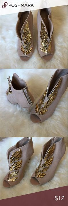 Gold wing high heels! Gold wing stiletto heels! Brand new with out tags! In perfect condition! Size 7! Anne Michelle Shoes Heels
