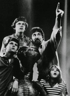 Steven Spielberg points upward, directing his young stars (clockwise from top) Robert MacNaughton (Michael), Drew Barrymore (Gertie) and Henry Thomas (Elliott). Between them is E.T., the title character of the film E.T., The Extra-Terrestrial. Amazon Prime Uk, Et The Extra Terrestrial, Henry Thomas, Day Lewis, Donald Glover, Adam Sandler, Steven Spielberg, Scene Photo, Vintage Movies