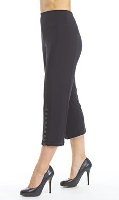 A pant with a drop-yoke waistband, a verticle-side double panel to flatter and slim hip area. This pant features a verticle-row of working buttons at the front hem. This pant pairs well with the many other Diva pieces. JOSS Boutique - Sympli Diva Capri, $179.00 (http://www.shopjoss.com/sympli-instock/sympli-diva-capri/)