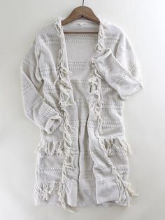 Cable Stripe Fringe Cardi. Cable knit striped fringe cardigan. Cream colored cardigan. Knit cardigan. Boho style. Boho fashion. Spring trend. Spring style. Spring outfit inspo at therollinj.com.