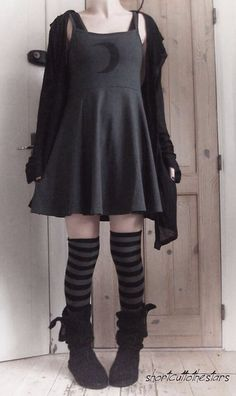 Via shortcuttothestars. I wouldn't wear those boots with those socks but the dress is adorable.