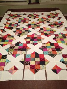 4 by 4 and an X - Easy quilt to make. Great layout.