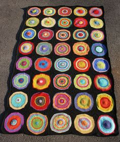 Could do multicolored granny squares, all with black or white outer rounds.