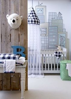 nursery wall city scape and stuffed bear head