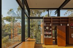 Nonzero Architects Apply Modernist Principles to Contemporary Architecture - Mid Century Home Revolving Bookcase, Small Bookcase, Bookcase Door, Glass Wall Design, Hidden Rooms, Building A New Home, Mid Century House, Mid Century Modern Design, Interior Barn Doors