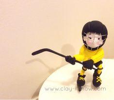 Boy playing ice hockey figurine
