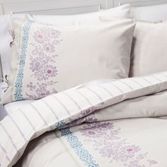 • 100% cotton<br>• Functional tie detail<br>• Reversible from floral to stripe<br><br>The Emma Duvet Cover and Sham Set in Purple from Beekman 1802 FarmHouse is inspired by flour sack cloth that was used to make curtains and bedding. This duvet set has a pretty floral trim for a restful look.