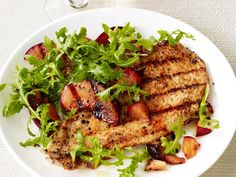Low-calorie Turkey Cutlets are kicked up with cayenne pepper and coriander. Fresh grilled plums and an in-season arugula salad complete the dish.