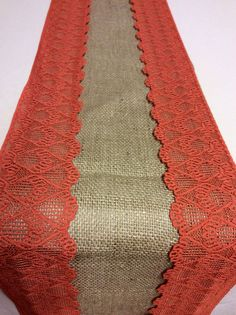 Here's an idea, but I'd prefer something instead of the burlap. These would be super cheap to make! 18ft Burlap Lace Runner with Burnt Orange by LovelyLaceDesigns, $58.50