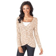 This ultimate figure-flattering faux-wrap design Oatmeal (white/tan combo) color wrap sweater is the perfect layer-friendly top. Featuring slimming side ruching, long sleeves, a v-neck and a high-low hemline that is designed to fall at the hip, the wrap style makes your waist look smaller and highlights your curves. 70% Polyester, 30% Rayon