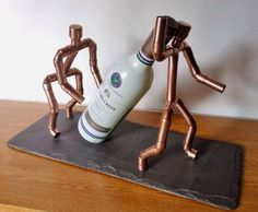 CopperMan Quirky Wine Bottle Holder by Copper illuminate.