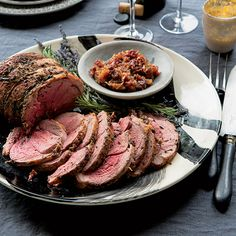 Roast Leg of Lamb with Rosemary and Lavender | This roast leg of lamb is rubbed with the classic combo of rosemary and garlic, but gets an unexpected twist with the addition of chopped fresh lavender. It's served with a sweet-and-sour shallot jam made from dates, honey and apple cider vinegar.
