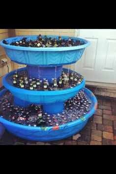 Go big or go home! Kiddie pool beer and beverage fountain. Put holes in pools to drain as ice melts