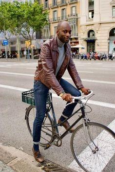 Fall fashion inspiration with a black leather jacket gray turtleneck slim denim brown shoes navy socks watch. model unknown. #fallfashion #falloutfits #menswear #menstyle #mensapparel #leatherjacket #turtleneck #mensfashion #bicycle