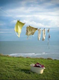 Clothes line by the ocean. can you imagine your laundry smelling like fresh sea air. Cottages By The Sea, Beach Cottages, Laundry Lines, Laundry Art, Laundry Room, Photo Macro, Blowin' In The Wind, Laundry Drying, Vintage Laundry