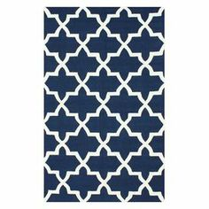 Effortlessly refresh your den, dining room, or master suite with this hand-tufted wool rug, showcasing a trellis motif in navy.   Product: RugConstruction Material: 100% WoolColor: NavyFeatures: Hand-hookedNote: Please be aware that actual colors may vary from those shown on your screen. Accent rugs may also not show the entire pattern that the corresponding area rugs have.Cleaning and Care: Spot treat with a mild detergent and water