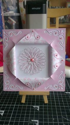 Pink and white with folded paper.
