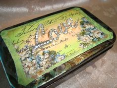 LOVE - ALTERED ALTOID MINT TIN  Upcycled Altoid tin features the word LOVE (from a piece of ultra-shine rhinestone jewelry) on top of the tin