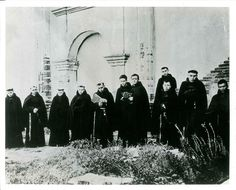 A class of Friars from the Seminary College circa 1912 standing in front of the Historic Church — at Mission San Luis Rey de Francia.