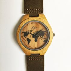 Wooden watch by freeforme this wooden watch features a world map wooden watch by freeforme this wooden watch features a world map design with engraved ticks you can choose from 3 different band colors black gumiabroncs Gallery