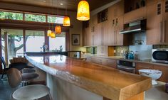 One of the first things that catches your eye in the house is the Madrona slab that Henderson milled to create a kitchen bar. He bought that chunk of wood for $1,800 on Craigslist.