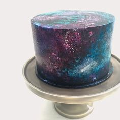 Stage 2 (see previous post)......Galaxy cake, blue tinted vanilla buttercake filled with sprinkle filled vanilla buttercream. Finished in black fondant panted with edible paint. ☄✨☄✨⭐️☄✨☄✨☄