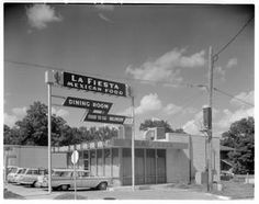 La Fiesta Mexican Food. Exterior view of La Fiesta Mexican Food Dining Room. Photo by Neal Douglass, Austin, Texas, June 20, 1962. Photo Courtesy of Austin History Center, Austin Public Library's Neal Douglass Photography Collection. http://texashistory.unt.edu/explore/collections/NDPC/browse/.