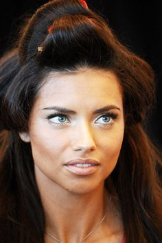 If you roll your hair in this exact pattern after it is freshly dried and spray it with hairspray, and leave it this way until you are finished with your makeup, you will have spectacular volume and angelic waves like Adriana Lima