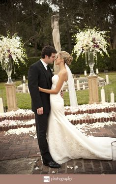 wedding day first look with ceremony floral arrangements www.mqphotography...