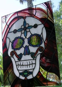 Stained Glass Day of the Dead Sugar Skull. I call it Death Smiles Sweetly. This is a custom made, one of a kind original work of art featuring 93 hand cut pieces of glass.