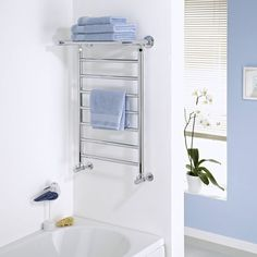 Keep towels warm, dry and organised with the Milano Pendle chrome heated towel rail