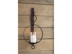 Hang out in style. Bring warmth and flair to an overlooked space with Ogaleesha wall sconce and candle holder. Dark bronze-tone metal and clear glass make a striking combination. Aligned or staggered, they're even more beautiful when paired. Bronze Wall Sconce, Rustic Wall Sconces, Bathroom Wall Sconces, Modern Wall Sconces, Candle Wall Sconces, Wall Sconce Lighting, Wall Lamps, Colonial, Traditional Wall Sconces